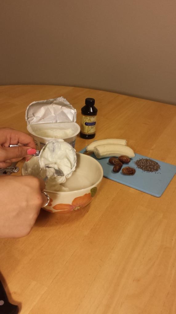 Adding the Greek yogurt to the almond milk